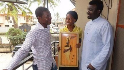Afonapi Emmanuel and Oseni Bukona, who live in Lagos's Ajegunle slum, with their